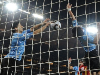 Luis Suarez blocks the ball out deliberately to deny Ghan a match-winning goal. AFP