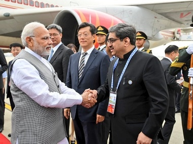 Prime Minister Narendra Modi being welcomed upon his arrival in Qingdao. Twitter @MEAIndia