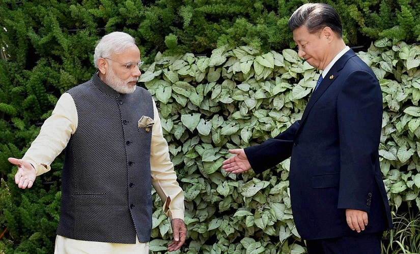 A file image of Prime Minister Narendra Modi with Chinese President Xi Jinping. PTI