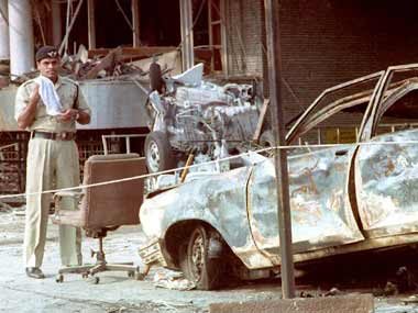 A damaged car after the serial blasts in Mumbai in 1993. AFP