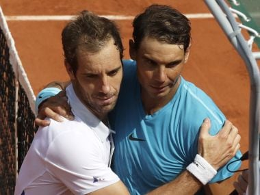 Rafael Nadal, right, hugs Richard Gasquet after their third round match at French Open. AP