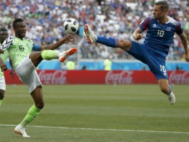 Nigeria's John Obi Mikel, left, and Iceland's Gylfi Sigurdsson compete for the ball during the Group D match. AP