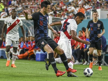 Peru's Renato Tapia (R) vies for the ball against Nikola Kalinic of Croatia (L) during their 2018 World Cup friendly. AFP