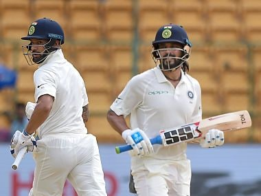 Bengaluru: India's Shikhar Dhawan and Murali Vijay run between the wickets on the first day of the one-off cricket test match against Afghanistan, at Chinnaswamy Stadium in Bengaluru on Thursday, June 14, 2018. (PTI Photo/Shailendra Bhojak) (PTI6_14_2018_000034B)