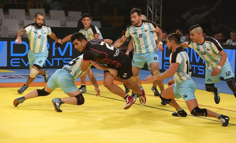 Argentina players tackle an Iranian raider during their clash at the Kabaddi Masters Dubai. Image Courtesy: Star Sports