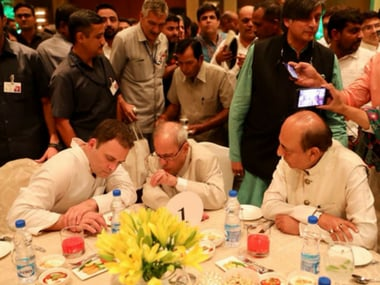 Former president Pranab Mukherjee with Rahul Gandhi at the iftar party on Wednesday. PTI