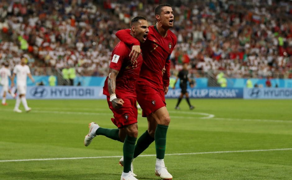 Portugal's Ricardo Quaresma celebrates scoring their first goal with Cristiano Ronaldo. Portugal came perilously close to a group stage exit during a frenetic stoppage-time period when Iran equalised through a penalty and almost scored a winner after Ronaldo had earlier missed from the spot. Reuters