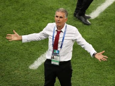Iran coach Carlos Queiroz appeals for a VAR review during the Portugal match. Reuters