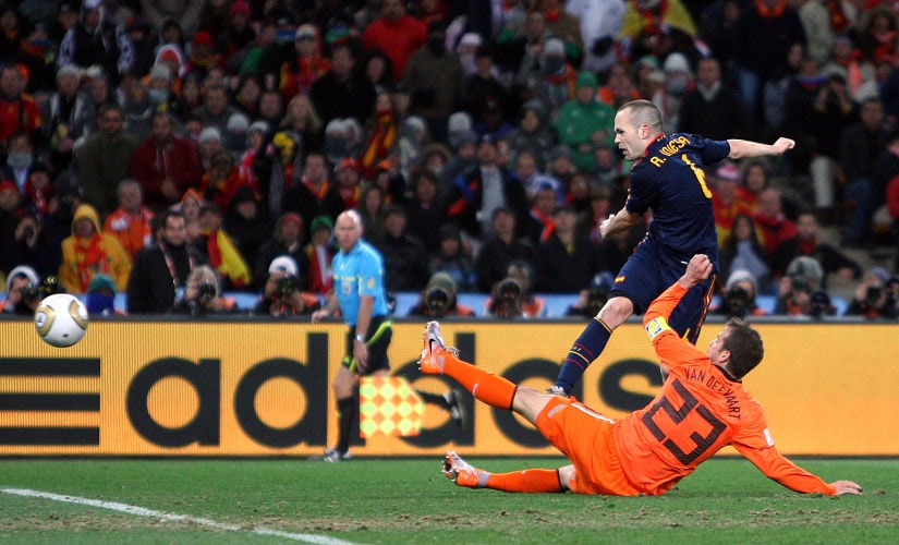Football- Holland v Spain FIFA World Cup Final- South Africa 2010- Soccer City Stadium Johannesburg South Africa- 11/7/10 Andres Iniesta scores the first goal for Spain under pressure from Holland's Rafael Van Der Vaart Mandatory Credit Action Imag