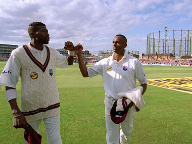 Cricket - England v West Indies , Wisden Trophy , 5th Test - 3/9/00 Mandatory Credit: Action Images / Andrew Budd Curtley Ambrose and Courtney Walsh walk off the pitch together after playing their last Test Match - MT1ACI229315