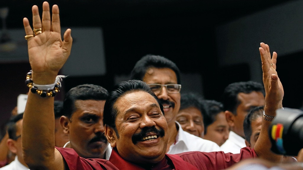 Rajapaksa waves at his supporters after winning the local government election in Colombo. — REUTERS