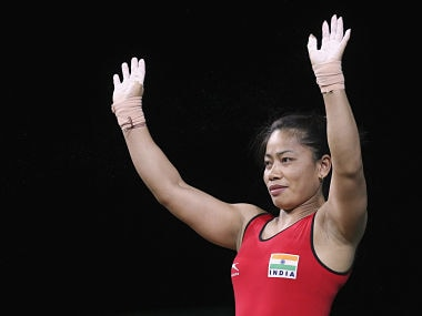 Weightlifting - Gold Coast 2018 Commonwealth Games - Women's 53 kg Final - Carrara Sports and Leisure Centre - Gold Coast , Australia - April 6, 2018. Sanjita Chanu Khumukcham of India waves. REUTERS/Athit Perawongmetha - UP1EE4602CTBG