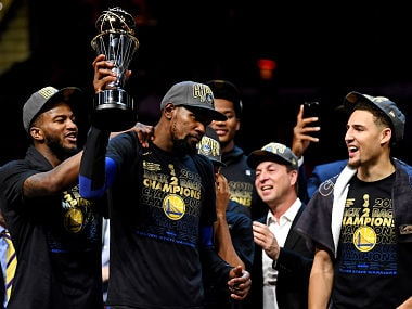 Jun 8, 2018; Cleveland, OH, USA; Golden State Warriors forward Kevin Durant (35) celebrates with the Bill Russell NBA Finals Most Valuable Player Award after beating the Cleveland Cavaliers in game four of the 2018 NBA Finals at Quicken Loans Arena. Mandatory Credit: Kyle Terada-USA TODAY Sports - 10881597