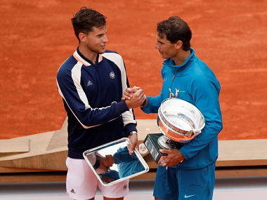 Tennis - French Open - Roland Garros, Paris, France - June 10, 2018 Spain's Rafael Nadal shakes hands with Austria's Dominic Thiem after winning their final REUTERS/Gonzalo Fuentes - RC118D849100