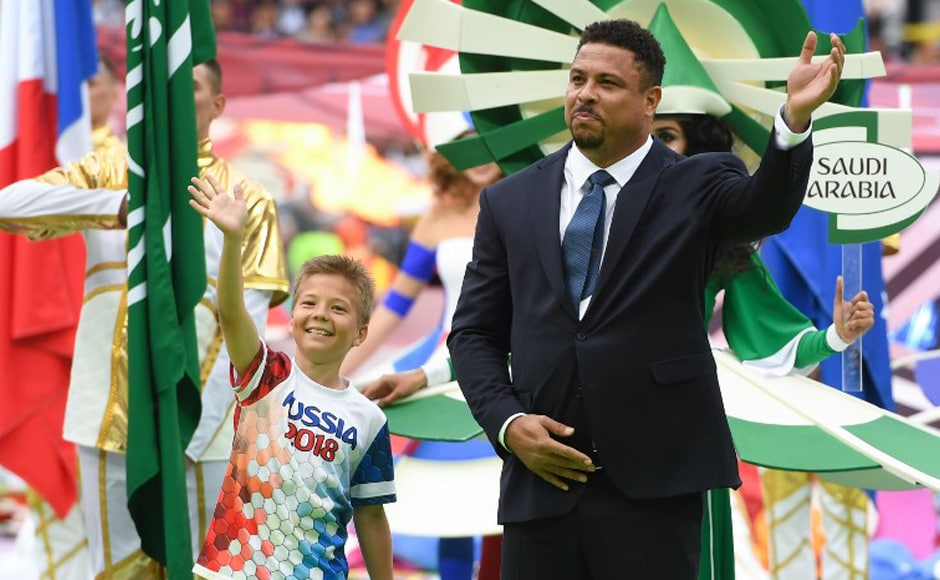 Brazilian football legend Ronaldo waves during the Russia World Cup opening ceremony before the tournament's first match between Russia and Saudi Arabia on 14 June, 2018 at Moscow's Luzhniki Stadium. AFP