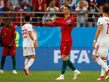 Portugal's forward Cristiano Ronaldo (2nd-R) reacts during the Russia 2018 World Cup Group B football match between Iran and Portugal at the Mordovia Arena in Saransk on June 25, 2018. / AFP PHOTO / Jack GUEZ / RESTRICTED TO EDITORIAL USE - NO MOBILE PUSH ALERTS/DOWNLOADS