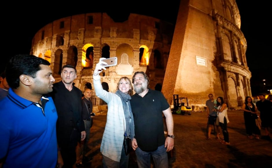 Russell Crowe at the Colosseum in Rome a day before the charity show, Gladiator in Concert. Image from AP/Riccardo Antimiani