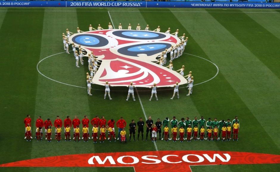 Russia, left, and Saudi Arabia stand on the pitch ahead of their Group A match. The Saudis were ranked three places above Russia at 67 in the world rankings. AP