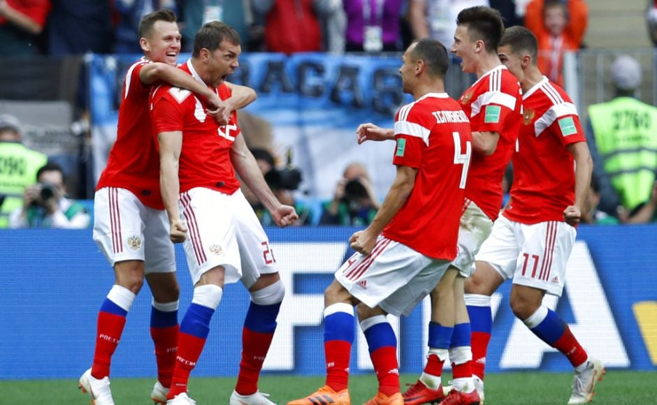Russia's Artyom Dzyuba, second from left, celebrates after scoring his side's third goal. Dzyuba headed Russia's third in the 71st minute - 89 seconds after coming on as a substitute. Cheryshev and Aleksandr Golovin hit a further two in injury time, the latter from a free kick, to complete the visitors' misery. AP