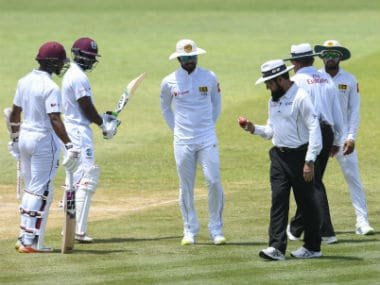 The umpires inspect the ball on Day 3 of the 2nd Test at St Lucia. AFP