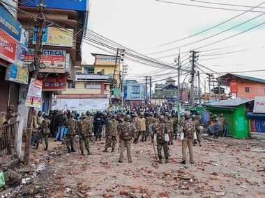 File image of policemen standing guard in Shillong after curfew. PTI
