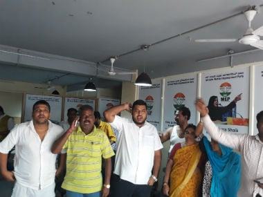 Candidates and their kin shout slogans against the MEP at party's Bengaluru headquarters. Image courtesy: Y Maheswara Reddy