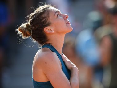 Simona Halep celebrates after victory over Andrea Petkovic in the third round of French Open. AFP