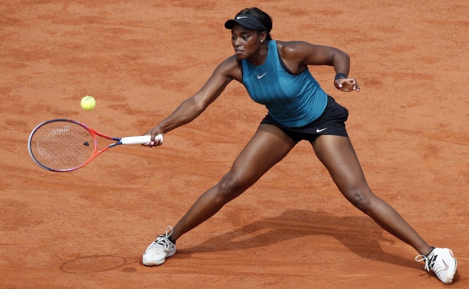 Sloane Stephens returns the ball to Simona Halep during the first set. Stephens struck first with break in the fourth game for a 3-1 lead and then sealed the opening set 6-3. AP