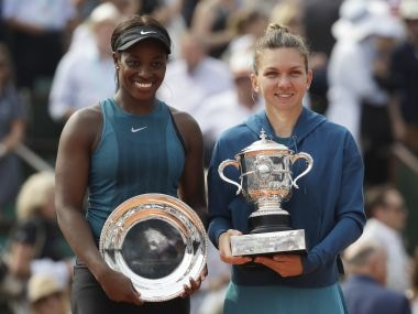 Simona Halep, right, holds the French Open trophy as she poses with runner-up Sloane Stephens after the final. AP