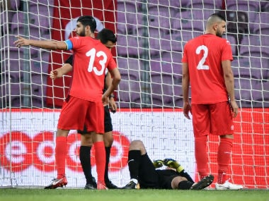 Mouez Tunisia's goalkeeper Mouez Hassen (C) lays down next to midfielder Ferjani Sassi (L) and defender Syam Ben Youssef during the friendly football match between Tunisia and Turkey. AFP