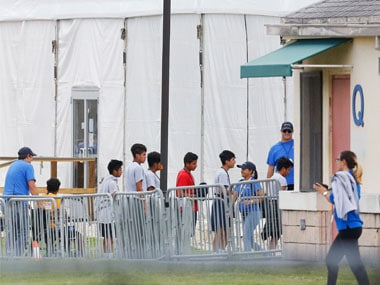 Immigrant children walk in a line outside the Homestead Temporary Shelter for Unaccompanied Children in Florida, a former Job Corps site that now houses them, on Wednesday. AP