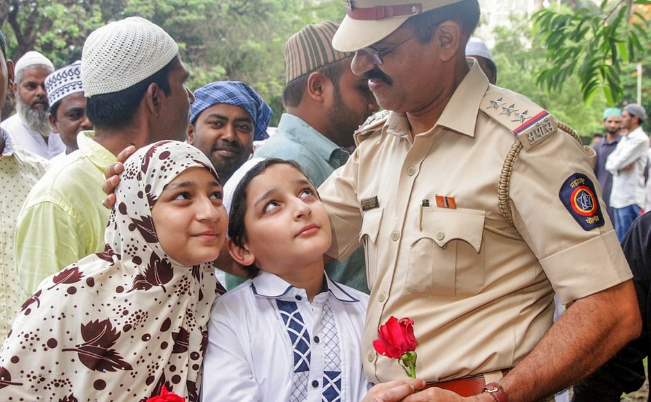 Children hugged policemen on the occasion of Eid-ul-Fitr in Mumbai. They offered flowers, sweets and thanked them for their service. PTI