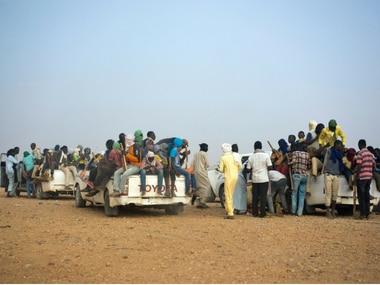 Expelled migrants from Algeria fleeing to Libya. AP