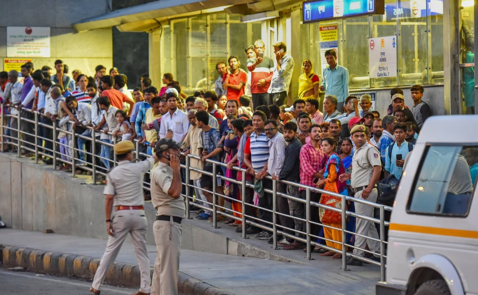 Security personnel manage a crowd gathered outside All India Institute of Medical Sciences (AIIMS). According to a report, the 93-year-old leader will be under the supervision of AIIMS director Randeep Guleria. PTI