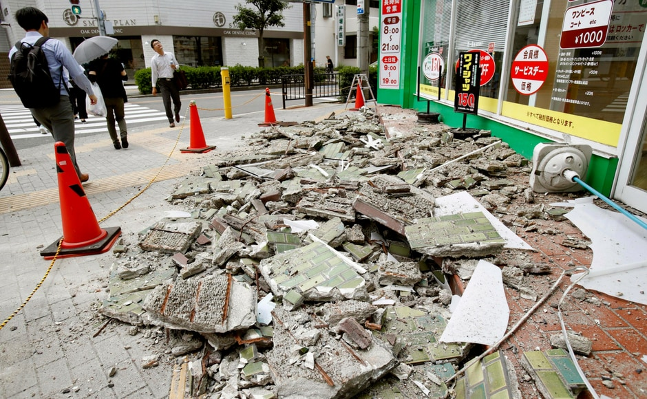 Walls were knocked over all over the city and the death toll is 3 till now. Kyodo News via AP
