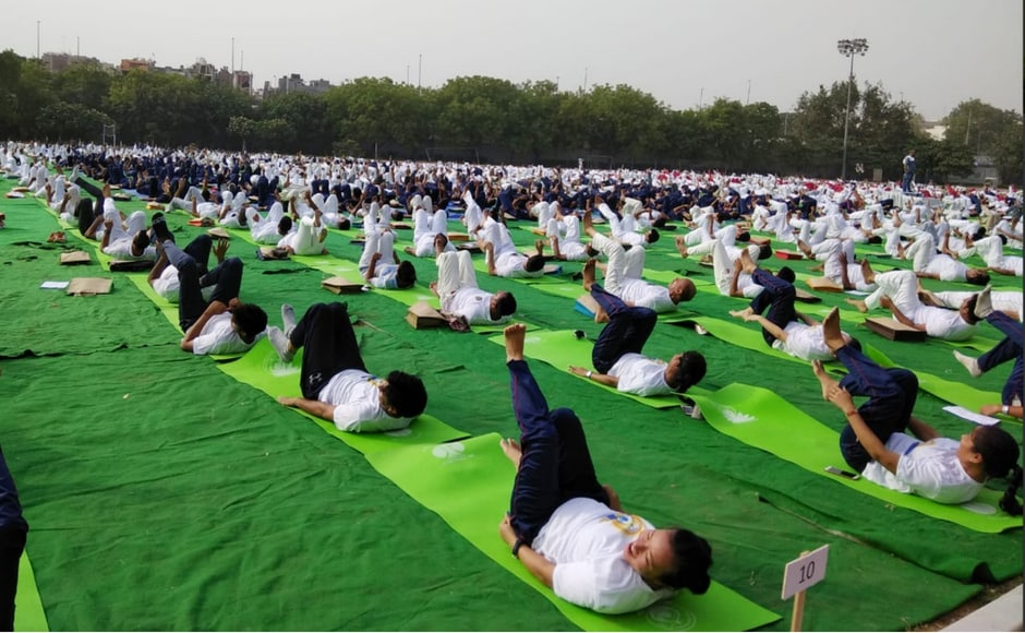 Delhi Police members perform yoga in Thyagaraj Stadium in New Delhi. The police commissioner said that the lifestyle of a police person was full of stress and stated he wanted to spread more awareness about yoga in the department. Twitter/@PIB_India