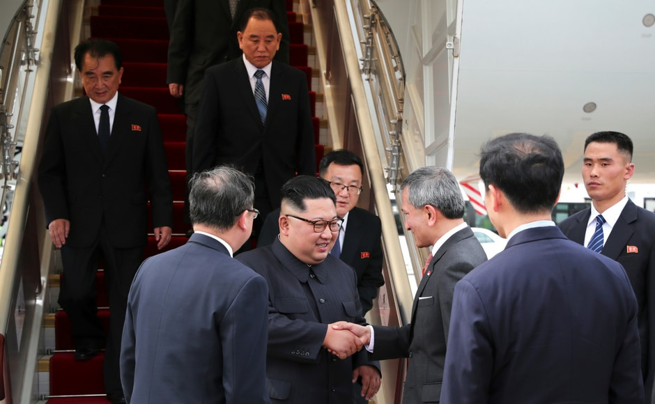 "In this photo released by the Ministry of Communications and Information of Singapore, North Korean leader Kim Jong-un, centre left, is greeted by Singapore Minister for Foreign Affairs Vivian Balakrishnan at the Changi International Airport. Kim smiled broadly Sunday evening as he met with Singapore prime minister Lee Hsien Loong. ""The entire world is watching the historic summit between (North Korea) and the United States of America, and thanks to your sincere efforts ... we were able to complete the preparations for the historic summit,"" Kim told Lee. AP"