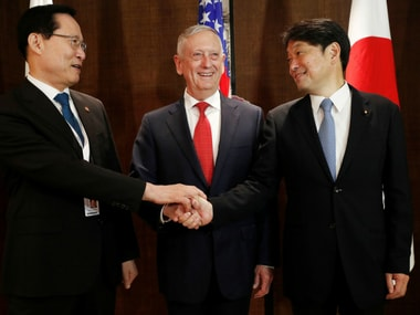 South Korea's defence minister Song Young-moo with his Japanese and US counterparts in Singapore. Reuters