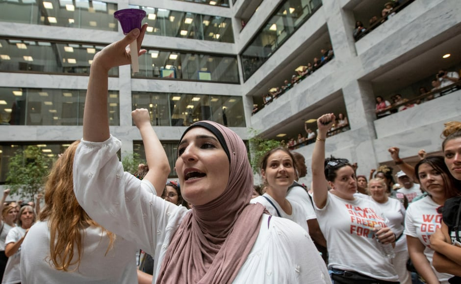 Linda Sarsour, co-chair of the Women's March who is seen ringing a bell said that civil disobedience was a strategic intentional tactic. AP