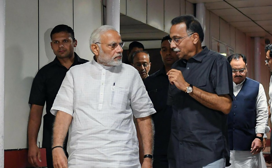 Prime Minister Narendra Modi talks to Ranjan Bhattacharya, the foster son-in-law of former prime minister Atal Bihari Vajpayee during his visit to All India Institute of Medical Sciences (AIIMS). Vajpayee has been admitted to AIIMS for a routine check-up, in New Delhi on Monday. PTI
