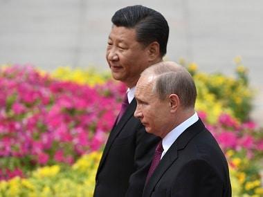 Russian president Vladimir Putin with Chinese president Xi Jinping. AP