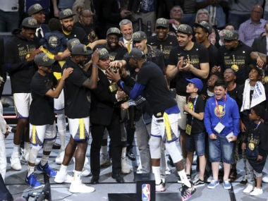 The Golden State Warriors celebrate after the Warriors defeated the Cleveland Cavaliers 108-85 in Game 4 of basketball's NBA Finals to win the NBA championship. AP