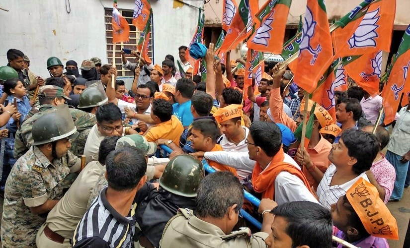 BJP workers clash with police over the alleged killing of BJP Dalit supporter in Purulia. PTI