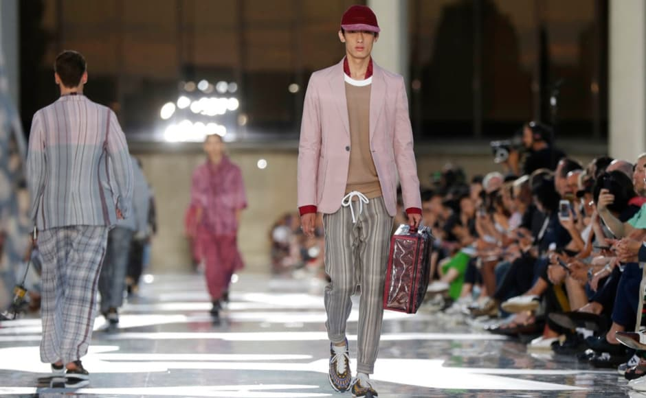 Zegna's technical looks were featured against an arched facade of the Mondadori Palace in Milan. The Associated Press/ Luca Bruno