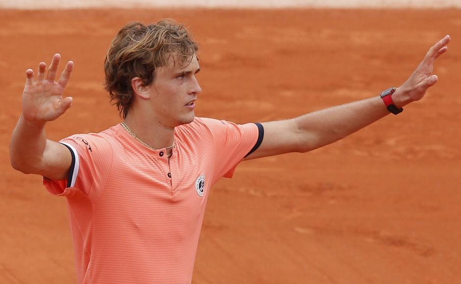 Germany's Alexander Zverev celebrates winning his third round match of the French Open tennis tournament against Bosnia and Herzegovina's Damir Dzumhur in five sets 6-2, 3-6, 4-6, 7-6, 7-5, at the Roland Garros stadium in Paris, France, Friday, June 1, 2018. (AP Photo/Michel Euler)
