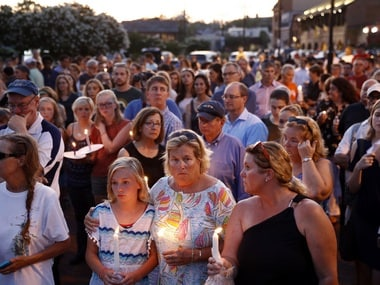 Mourners stand in silence during a vigil in response to a shooting at the Capital Gazette newsroom in Annapolis. AP