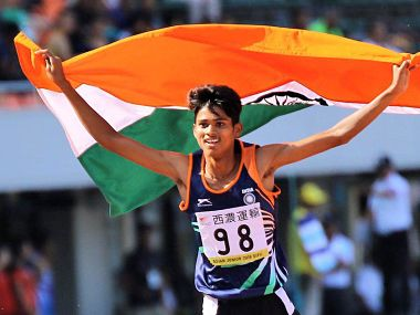 Anu Kumar running with the tri-colour after clinching the gold medal. Image courtesy: Twitter @afiindia