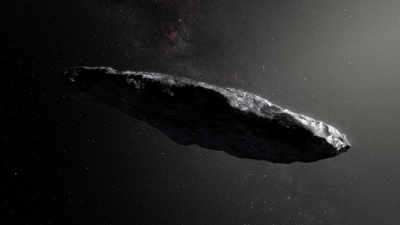 This artist's impression shows the first interstellar asteroid, `Oumuamua as it passes through the solar system after its discovery in October 2017. European Southern Obervatory/M. Kornmesser/Handout via REUTERS/Files