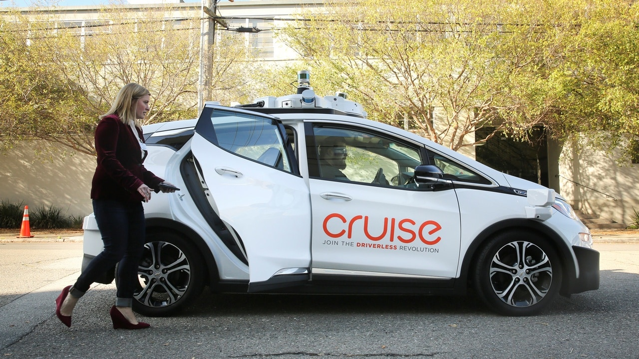 A woman gets in a self-driving Chevy Bolt EV car during a media event by Cruise. Image: Reuters