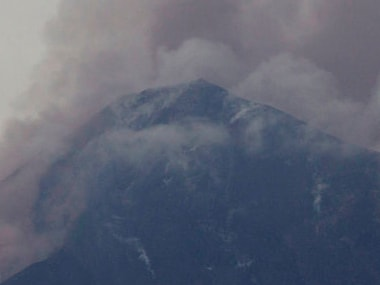 Volcan de Fuego, or Volcano of Fire, blows outs a thick cloud of ash, as seen from Alotenango in Guatemala. AP